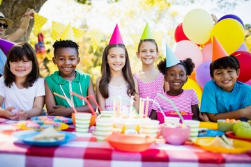Group of children smiling and posing during a birthday party