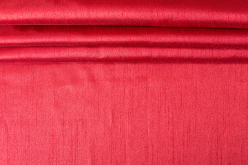 Rich red wavy fabric texture / background.