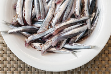 anchovies in the dish, clean and ready to be cooked.