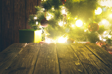 Blurred background of xmas tree lights with table
