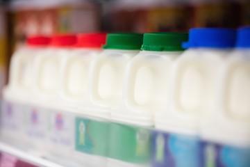 Milk bottles tidied in shelf