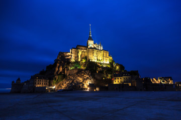 Night view of the abbey of mont saint michel.