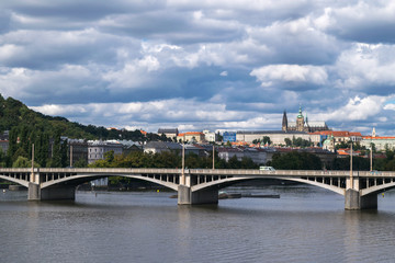 Dramatic sky, Autumn panorama with Vltava River and Prague Castle, Central Europe, Czech Republic