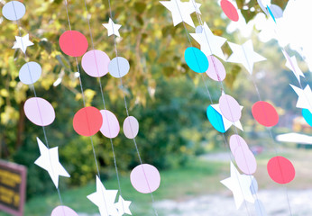 Decorations from paper butterflies on strings on a picnic.
