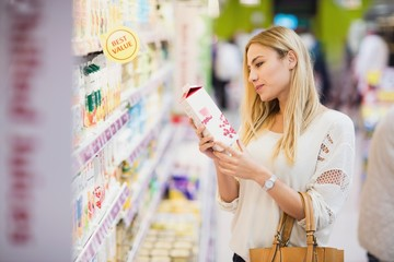 Customer looking at a bottle of fruit juice