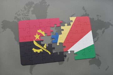 puzzle with the national flag of angola and seychelles on a world map.