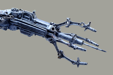 Left arm of a robot made from car parts and spares. Isolated on gray background