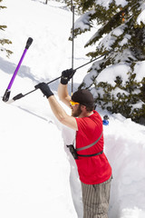 Backcountry skier in avalanche test pit