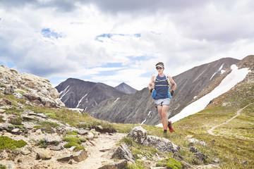 Ultra Runner passes down a trail from Torries Peak in Colorado