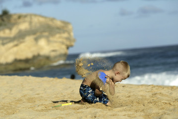 Boy playing on beach at Shipwreck Beach