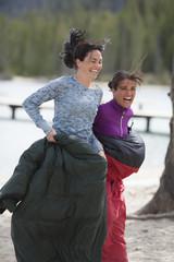 Two women in a sack race.