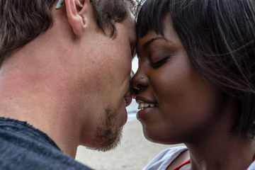 Close-up of passionate couple kissing at beach