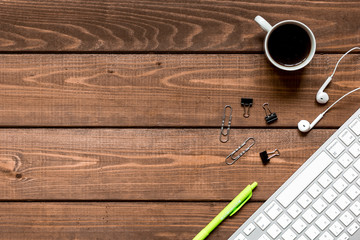 mans working place at wooden desktop with coffee