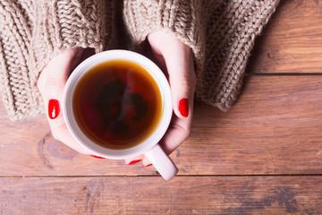 Tea in woman hand