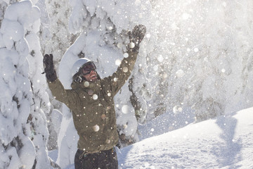 A male snowboarder smiles in Whitefish, Montana.