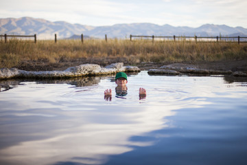 A woman relaxing in the Medow Hot Springs, Utah