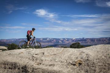 A woman mountain biking in Gooseberry Mesa, Utah