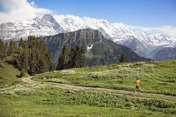 Man running in the Swiss Alps