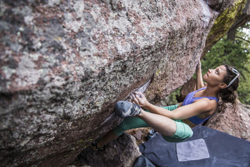Female rock climber preparing for her next move