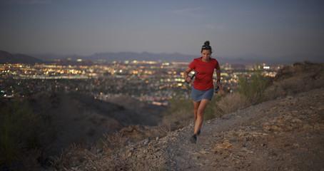 Woman trail running in South Mountain Park, Phoenix, Arizona November 2011.