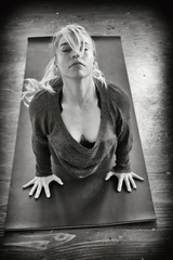 Black and White Portrait of a Beautiful Blond Woman Doing Yoga