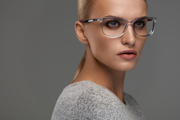 Female Eyewear. Woman In Beautiful Glasses Frame, Eyeglasses