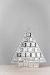 Shiny tree shaped advent calendar - beautiful countdown to Christmas .