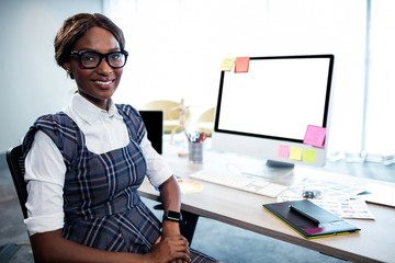 Smiling businesswoman posing with computer