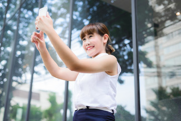 a beautiful girl taking selfie