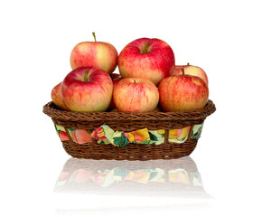 Ripe red apple in wicker basket isolated on white