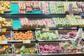 Side view of supermarket shelves