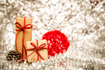 Christmas background with decorative red ball and gift.