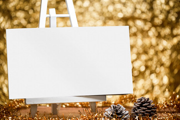 White photo album or photo book with blank cover on a golden wood background.