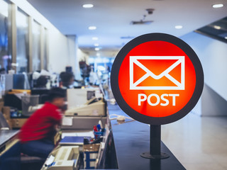 Post office Signage counter service with People working