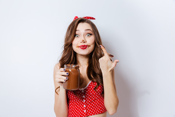 Young model eating chocolate cream