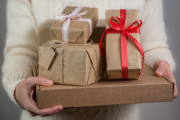 Female holding stack of christmas presents