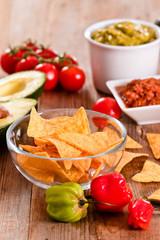Guacamole and nacho chips.