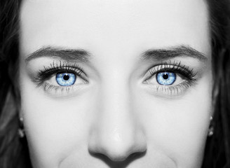 Beautiful insightful look blue woman's eyes.