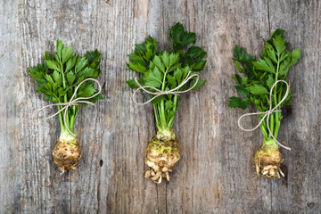 Root of celery with leaves, green vegetables, local market produce