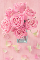 Close-up floral composition with a pink roses .Many beautiful fresh pink roses on a table.Vintage style .