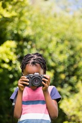 A child is taking picture with camera