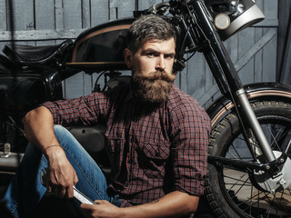 bearded biker man with wrench