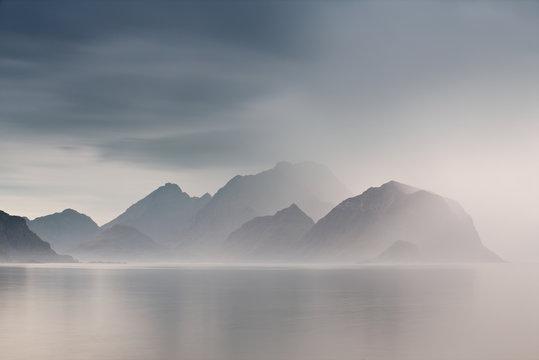 Summer cloudy Lofoten islands. Norway misty fjords.