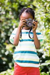 Portrait of boy taking pictures