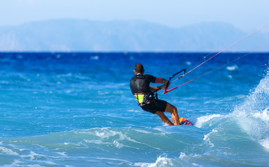 Kitesurfing, Kiteboarding action photos, man among waves quickly rides