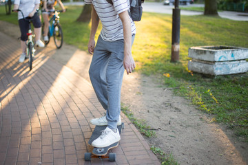 a man riding a skateboard in the park in the summer