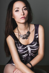 young woman in a black bathing suit gothic skeleton klstyum portrait