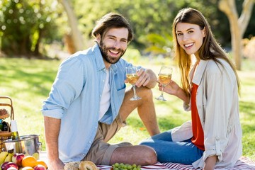 Portrait of couple holding glass of wine
