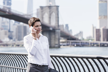 USA, Brooklyn, portrait of businesswoman on the phone