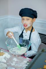 child baking christmas cookies